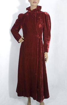 """Silk velvet evening coat, c.1936. Made from luxurious silk velvet, the elegant velvet evening coat captures the glamour aesthetic of the 1930s. The collar is tightly pleated around the neck to stand up and frame the face. The leg-of-mutton sleeves are puffed at the top. The opulent burgundy hue gives our luxe coat an enduring significance and charm. Indeed, it is a coat with an """"attitude,"""" conveying both old money assurance and the confidence of supreme stylishness."""