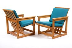 A pair Trybo easy chairs