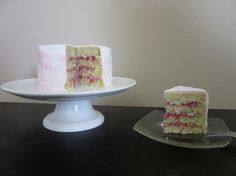 worlds moistest, richest yet fluffy and tender coconut cake (made with desiccated coconut, a lot of butter, extra egg whites and coconut milk)  with homemade sweet strawberry compote infused pink swiss meringue buttercream