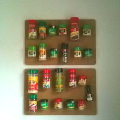 My DIY spice rack! Cork board, magnets and glue! Easy and organized.