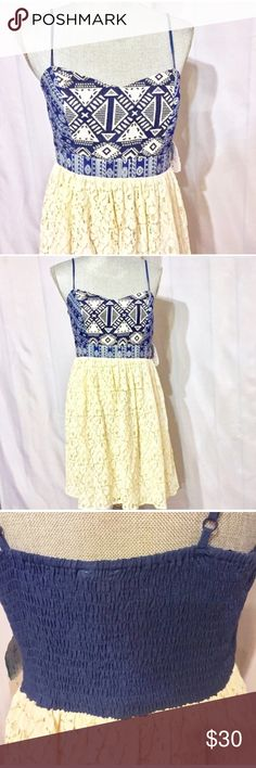 """Sz S Altar'd State Blue Woven Cream Lace Sundress NWT Gorgeous Homespun style bodice with cream Lace skirt. Elastic smocked back and adjustable straps. Sz Large Juniors but shown on Sz 4 mannequin. Fits closer to women's small. Unstretched measurements are bust 32"""", waist ( measurements coming) top of bodice at highest point to Lace skirt top is 8.5"""". Highest point of bodice to skirt bottom 28"""". Back is pretty stretchy so can adjust to size. Altar'd State Dresses Midi"""