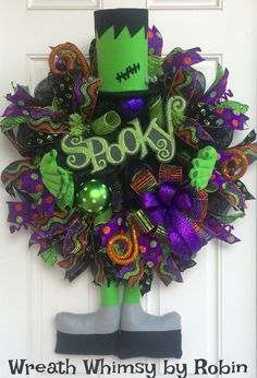 XL Frankenstein Halloween Deco Mesh Wreath with Spooky Sign in lime, Black & Purple.  This adorable take on a friendly Frankenstein character will be sure to delight all of the little ghosts and goblins in your neighborhood this year and for seasons to come!  This unique decoration is huge at approximately 30 inches in diameter, hanging 38 inches long and has a depth of 18 inches with the arms.  The wreath is constructed with metallic black deco mesh which is then layered with rolls of lime…