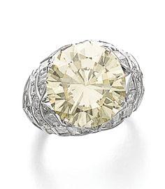 FANCY LIGHT YELLOW DIAMOND RING, BULGARI. The bombé mount centring on a brilliant-cut fancy light yellow diamond weighing 11.61 carats, accented with variously cut diamonds, size 53, signed Bulgari, numbered, maker's mark. Yellow Diamond Rings, Diamond Cuts, Bulgari Jewelry, Jewellery, Italian Jewelry, Diamond Are A Girls Best Friend, Fine Jewelry, Fancy, Jewels