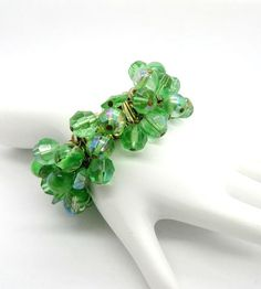 Vintage 1950s Green Crystal Bead Cha Cha Expansion Bracelet  The Inside diameter of the bracelet, unstretched is 2 It is signed Japan Smooth
