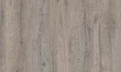 Grey Heritage Oak with realistic knots and cracks adds a rustic, reclaimed oak look to any space. This vinyl floor fits both modern and design oriented interiors, to super rustic country style. The plank design is perfect for rooms where you want the look of real wood, but the warmth, softness and waterproof properties of vinyl. Our new Optimum alternative with PerfectFold™ V click system gives a highly durable wear layer for commercial areas, and makes professional installation both faster…