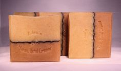 Orange clove soap has a new updated design. The wavy black line is called a chalk line, it's made with activated charcoal. The bottom part of the soap has Moroccan red clay and orange peel powder, the