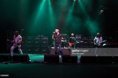 Luke Morley, Danny Bowes, Chris Childs and Ben Matthews of the band Thunder perform on stage at Hammersmith Apollo on July 11, 2009 in London, England.