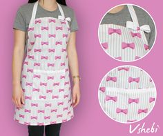 Pink bows on white printed classic cotton apron. This apron has a very handy pocket on the front. It's decorated with cute bow and lace ribbon. All aprons are one size but I'm open to customize it. Length: 71 cm Width: 74 cm Tie: 90 cm 100% Cotton