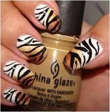 Flaunting animal themed nail art shows your wild side and it also depicts your love towards the animals or your pets. When we talk about animal nail art tutorial, it includes anything from leopard print nail arts to hell Tiger Nail Art, Tiger Nails, Animal Nail Art, Fancy Nails, Love Nails, Pretty Nails, Leopard Print Nails, Manicure E Pedicure, Fabulous Nails