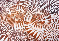 Linocut by Jackie Curtis based on ammonite fossils from Kilve beach. The colours are inspired by the rust and ochre colours found in the rocks on the beach.  Exact colour may vary as the block is inked with two colours.