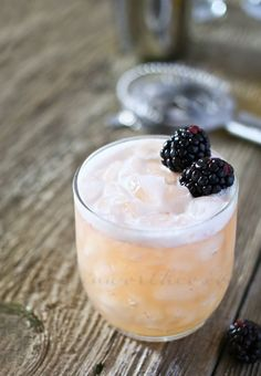 Blushing Whiskey Sour - I think you should muddle the blackberries, though, to get all the good juice.