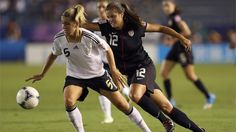 TOKYO, JAPAN - SEPTEMBER 08: Katie Stengel of the USA tries to tackle Luisa Wensing of Germany during the FIFA U-20 Women's World Cup Final match between USA and Germany at the National Stadium on September 8, 2012 in Tokyo, Japan. (Photo by Ian Walton - FIFA/FIFA via Getty Images)