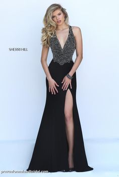 Black evening gown. Black Sherri Hill prom dress. Black Sherri Hill evening gown. Black dress with deep low-v neckline.
