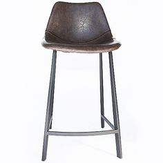 The IonDesign Peralta Bar Stool is quite the catch. The seat has the feel and look of real leather, but it is actually artificial leather made out of polyurethane. Baseball mitt style stitching helps the material mold seamlessly into the bucket seat shell, which sits on a tall brushed stainless steel base.