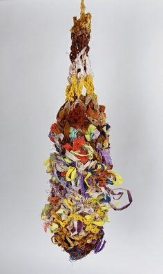 Fiber art: hand dyed, crocheted bird pod.