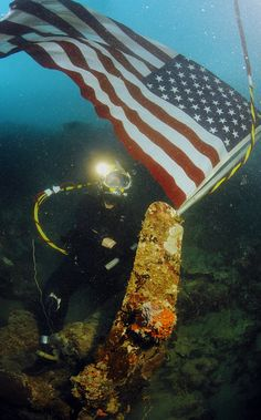 US Navy diver plants American flag on US aircraft shot down in WW II by AN HONORABLE GERMAN, via Flickr