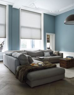 The muted colors of the couch and walls harmonize well with each other. Home Living Room, Grey Couch Blue Walls, Home, Home Furniture, New Homes, House Interior, Home Deco, Living Room Inspiration, Home And Living