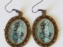 Earrings with a micro drawing