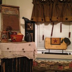 Primitive decor with sheep and crow. I love decorating with sheep and crows.