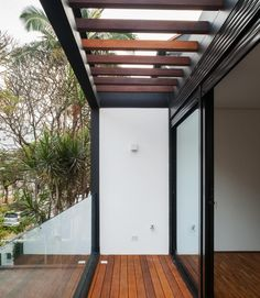 Decoration Outdoor. Picturesque Modern Pergola for Your Beautiful Garden Decor Enhancer: Mesmerizing Small Space Patio Deck With Wooden Roofs Also Black Finished Frames Modern Pergola Added Wooden Floors As Exterior Modern House Ideas