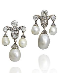 A pair of 19th century natural pearl and diamond earrings. Each collet-set old brilliant-cut diamond fleur-de-lys surmount, suspending three natural pearl drops with rose-cut diamond caps, diamonds approximately 2.45 carats total.