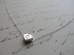 Silver initial charm necklace tiny heart initial by OliveYewJewels, $31.00