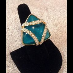 Teal Double-Triangle Ring On gold setting this ring has flat iridescent stones as an embellishment. Stretch ring that fits all sizes. Jewelry Rings