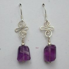 Amethyst earrings. Faceted amethyst nuggets hang from sterling silver wire…