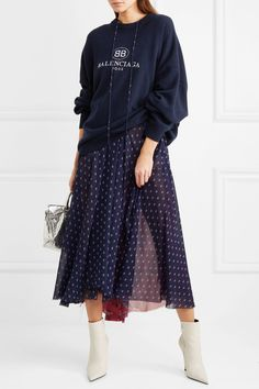 Think flowy skirts paired with mega sneakers and logo sweaters worn with logo bags by Balenciaga.
