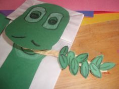 We made these cute paper lunch bag dinosaur puppets.