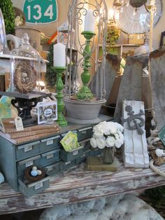 Love this booth set up. Lots of layers and multi materials.