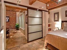 Love the sliding door to the bedroom.