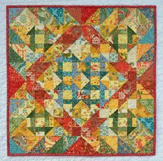 """Butter Churn quilt (churn dash) at IslandLife Quilts. She used both Portugal and Prayer Flag fabric lines. The pattern is from """"This and That"""" by Sherri K. Falls."""
