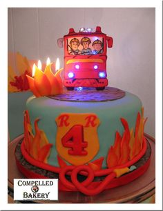 Fireman Sam Cake- We did this for my son. We made a photo of him to look like he is a passenger in the engine plus it had real working lights and a REAL fire! :) #firemansam 1 Tier cake, fire engine cake.