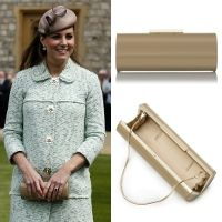 The Duchess of Cambridge first carried this roll clutch from L.K. Bennett when she attended the National Scouts Parade at Windsor Castle in April 2013. The 'Avona' is an oval structured roll clutch, crafted from beautiful gloss patent leather. It is finished with goldtone hardware and has a concealable snake strap. It retailed for £195/US$295.
