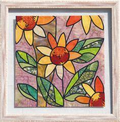 quadre amb vidrieres, quadre de flors i tapís fets per mi