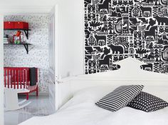 scandinavian - love the idea of hanging a design textile behind the bed.