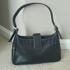 Black Coach Purse Genuine leather athentic Coach handbag. Slight defect on bottom seam (see photos) otherwise very good condition. Coach Bags Shoulder Bags