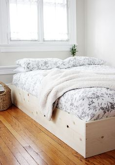 I've been pinning lots of bedrooms that have the bed laying right on the floor piled with cozy blankets and pillows. I recently got a new mattress and didn't want to buy a bed frame for it so I left i