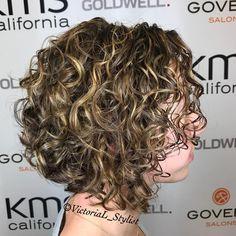 Angled Curly Blonde Balayage Bob