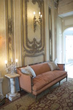 Delightfully distressed 18th-century Neo-Classical/Rococo panels from a French chateau, encrusted with glimmering gilt floral and shell motifs.