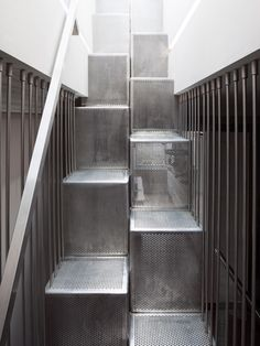 This staircase inserted into a terraced house in London features alternating treads that make the most of a tight space.