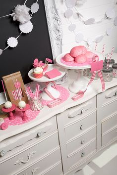 Cute!! I really like the pink dolies here, too! My sister has a TON of white cake stands, too! I can borrow those from her!