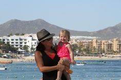 Girls on the beach in Cabo!! Avery loves the sand and the water!