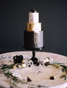 Our Favorite Wedding Cakes from 2016 | Black, Gold + Marble Cake