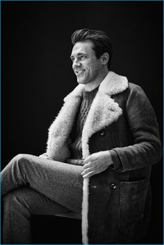 Embracing the shearling trend, Jon Hamm wears a Saint Laurent double-breasted shearling coat, Maison Margiela cable-knit sweater, and Brunello Cucinelli slim-fit houndstooth wool trousers.