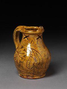puzzle jug ...lead glazed with incised slip ...english (donyatt)