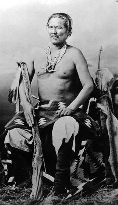 """Manuelito, Navajo man He holds a rifle in a buckskin scabbard and wears moccasin boots, a blanket, and bead necklaces with a saber pendant. """"Manuelito, the once fierce chief of the Navajo"""" and """"Saved Navajo Bill's Life Once"""" hand-written on back of print. Native American Images, Native American History, Native American Indians, Native American Jewelry, Cheyenne Indians, Sitting Bull, Indian Heritage, Native Indian, Red Indian"""