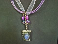 Say Happy New Year with a picture of a loved one! Lavender corded ribbon necklace with a locket by rowdylady, $25.00
