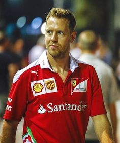 Sebastian Vettel (with a new haircut), walking in the Marina Bay paddock last…